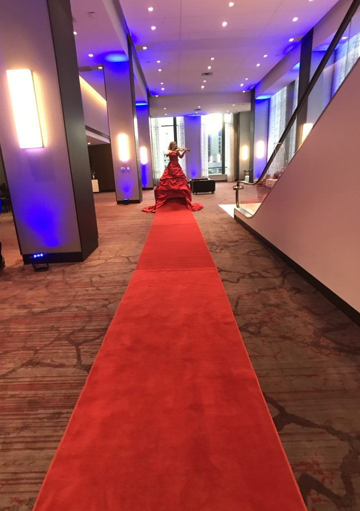 Violinist on red carpet Hilton Rochester Mayo Clinic Area 100th anniversary